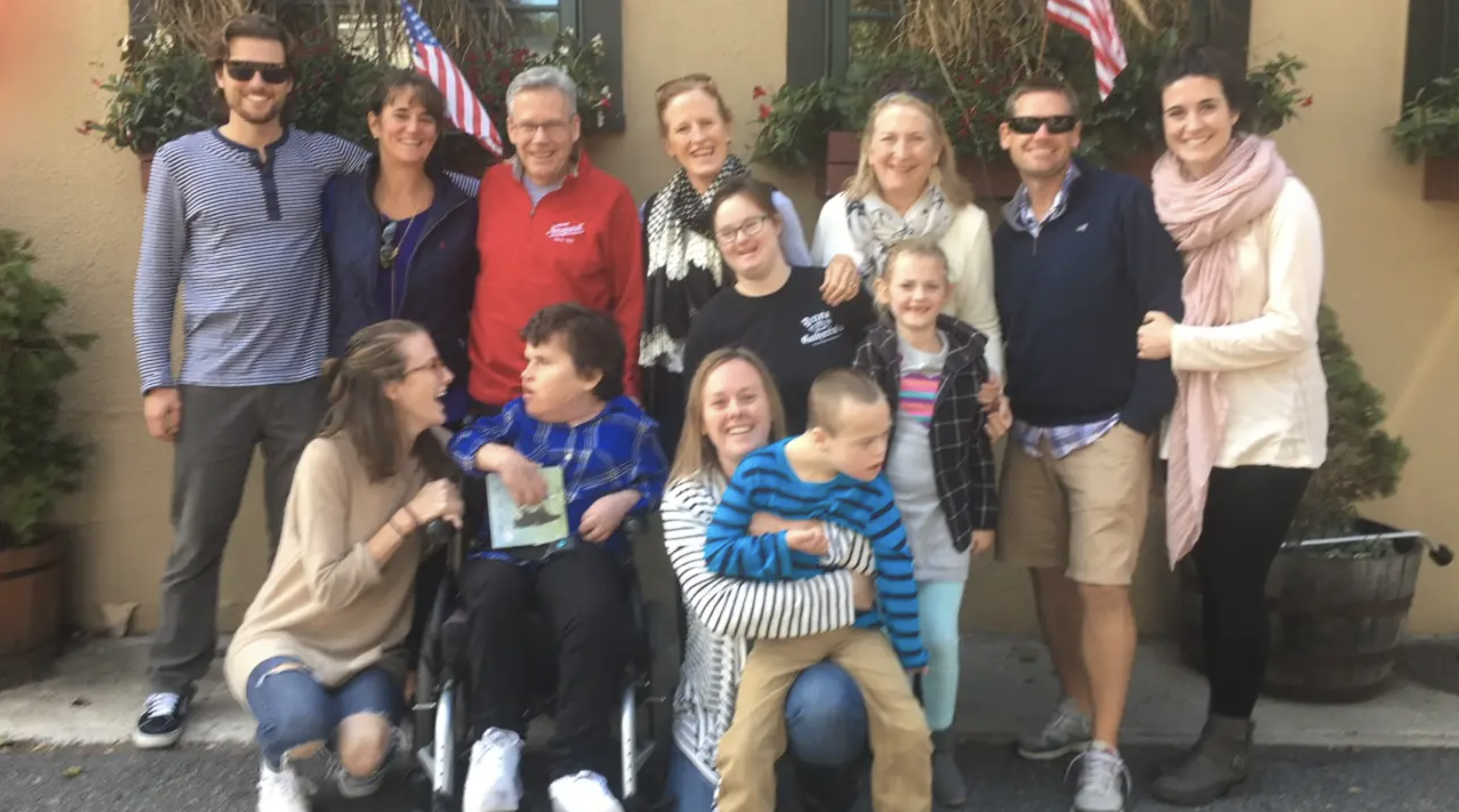 Image of Kelsey and her family. There are about 13 of them.