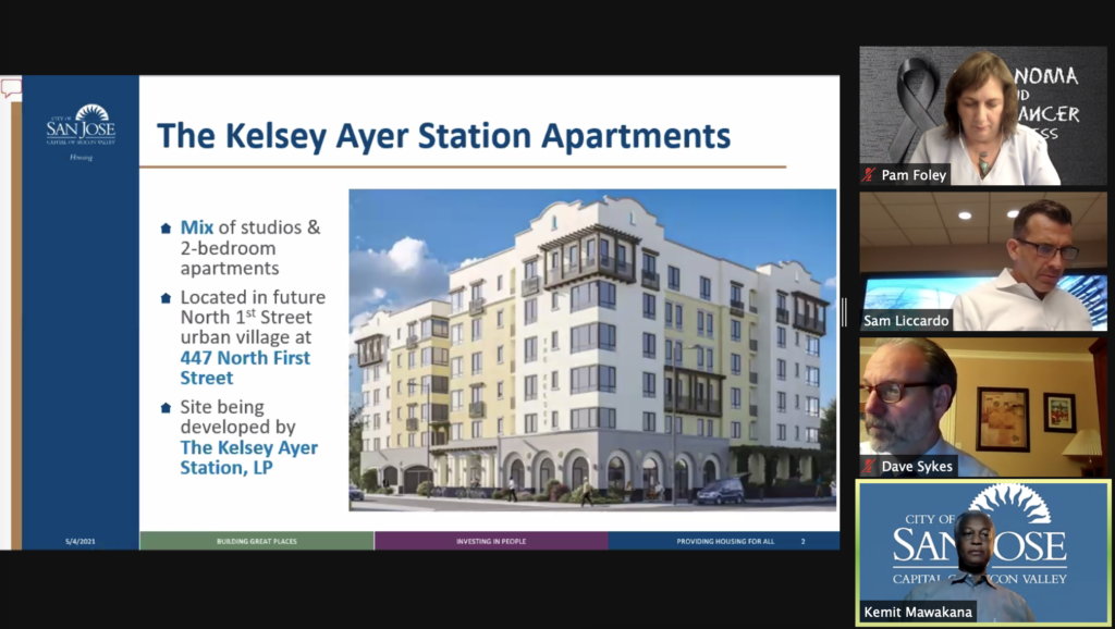 Image of The Kelsey Ayer Station being reviewed in San Jose City Council Meeting with four people shown on right. One of them being Mayor Sam Liccardo. There is one woman and two other men.