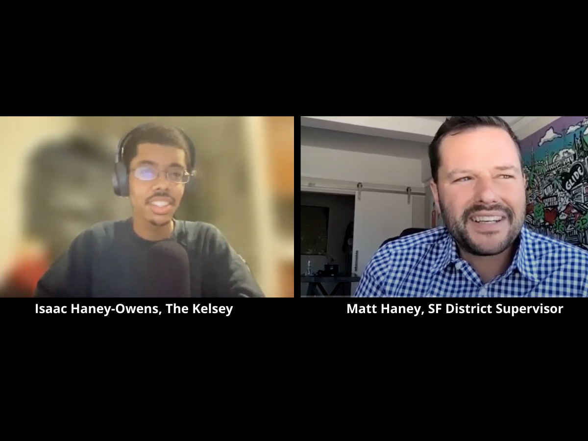 image of Isaac and Supervisor Haney. Isaac is a mixed race black autistic man smiling at camera with glasses, headphones, and microphone. Supervisor Haney is middle aged white man with short black hair and wearing blue checkered button down shirt.